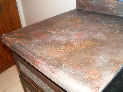 ... look on the kitchen cabinets and faux slate countertops